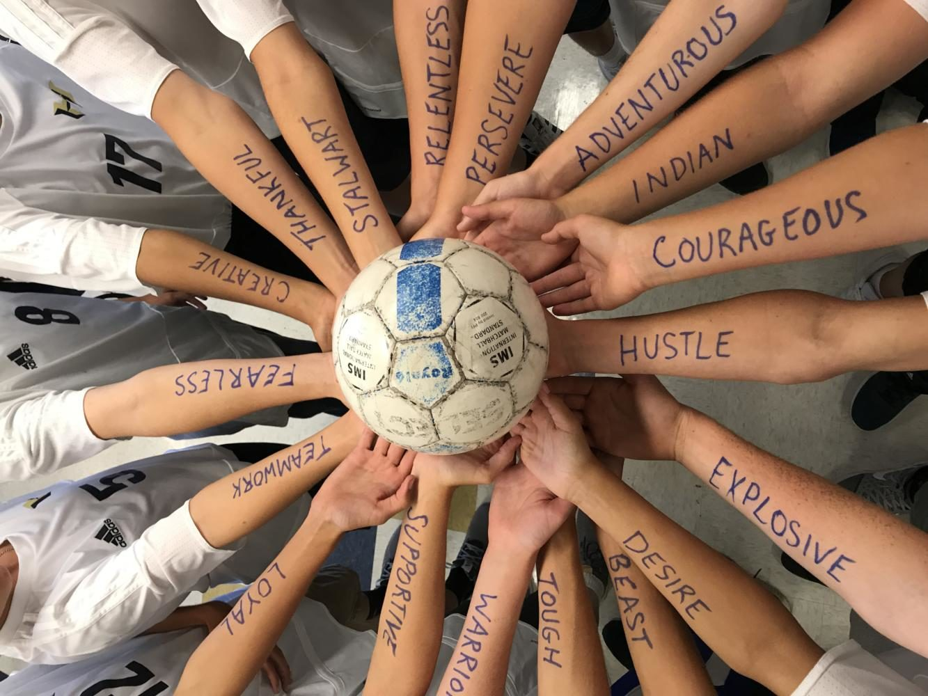 Inspired+by+the+words+on+their+arms%2C+the+freshman+soccer+team+comes+back+from+0-3+halftime+score.