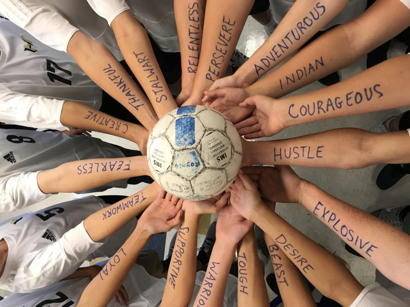 Inspired by the words on their arms, the freshman soccer team comes back from 0-3 halftime score.