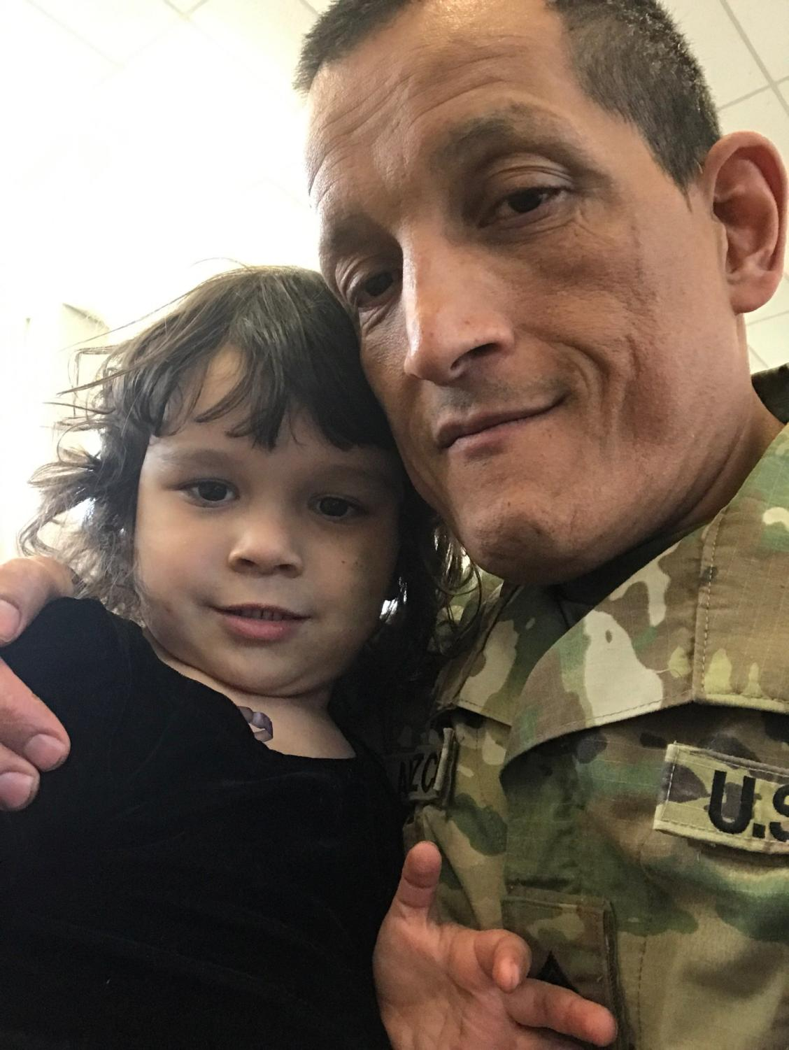 Officer Ricardo Amezcua and his 4-year old daughter Kayla are luckily safe from harm.