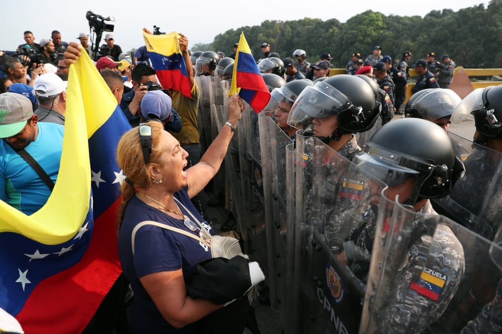 Columbian civilians stand off with Venezuelan forces at the border.