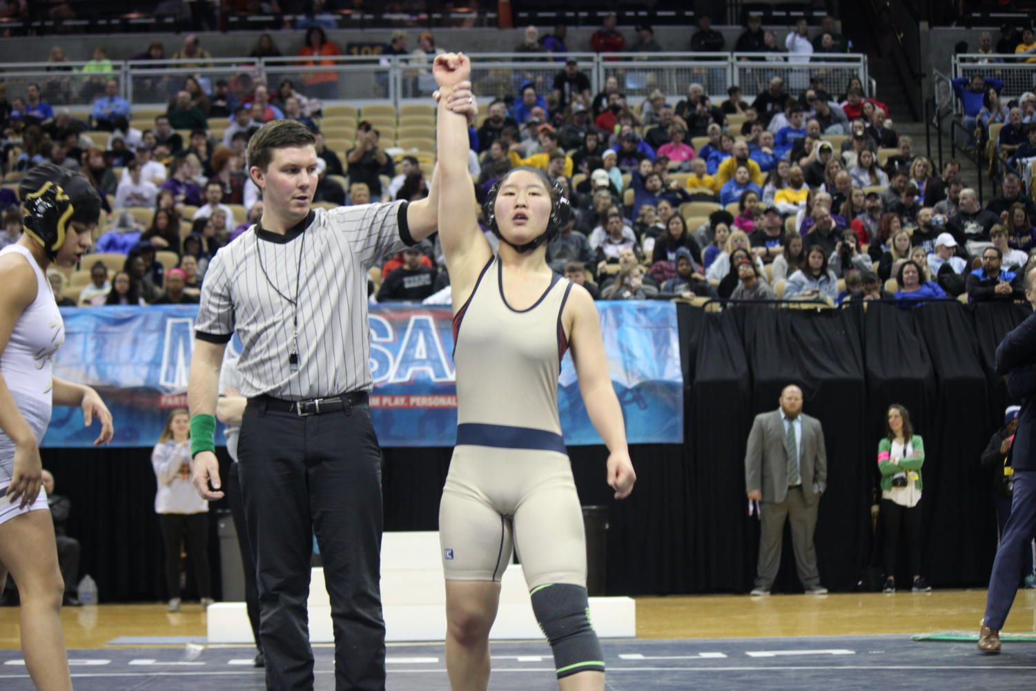 Esther Han ('22) takes home the gold at the Wrestling State Tournament.