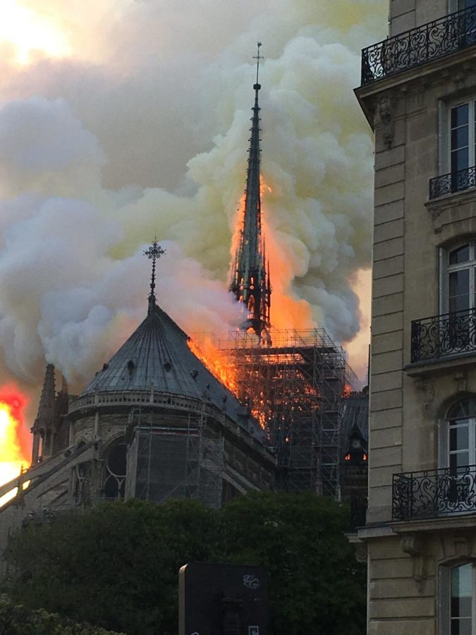 Tourists+and+French+citizens+alike+watch+in+horror+as+a+piece+of+their+history+burns+in+front+of+the.