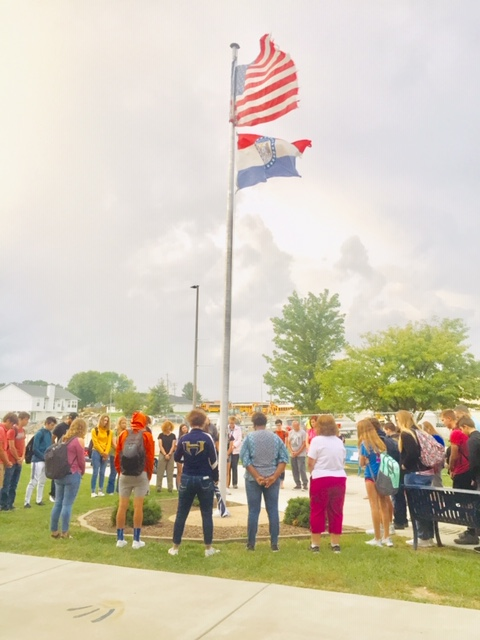 Students+and+faculty+share+a+prayer+at+the+flagpole+on+Global+Day+of+Student+Prayer.