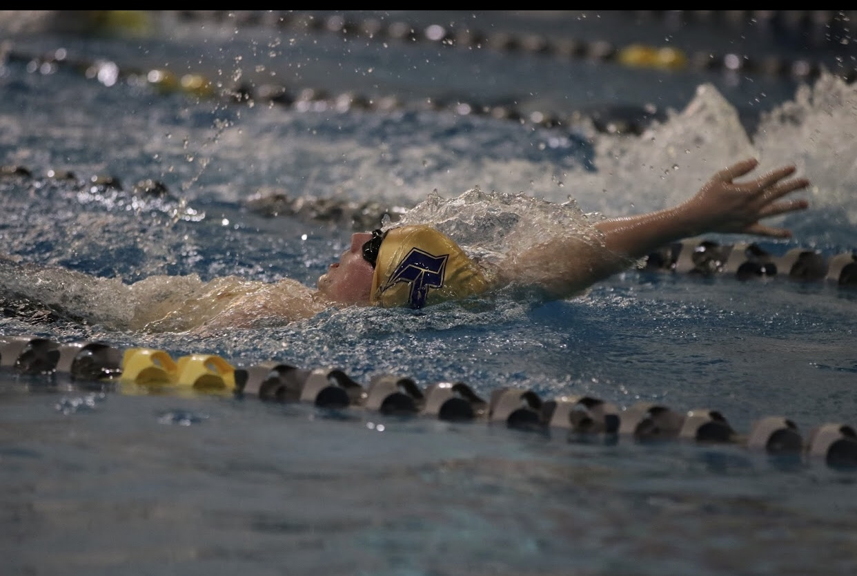 Talon Green swimming at GAC's. Performing the Backstroke advancing to state.