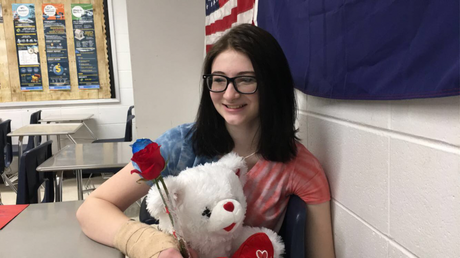 Alexis Stratman ('22) holds all of the gifts she recieved for Valentine's Day.