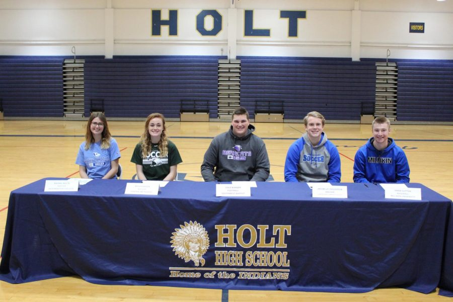 Five+athletes+at+Holt+prepare+to+sign+for+the+next+four+years.