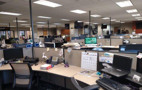 Photo of a near empty newsroom similar to many currently.