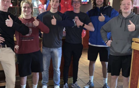 Kade Bickel ('21) and Connor Dalton ('21) pose for a picture with their friends at Red Robin. The two have been working so hard this year and really want to make a difference.