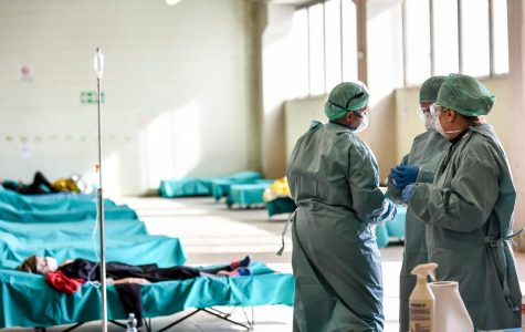 Healthcare professionals work in one of the emergency structures to easily take care of the many COVID-19 patients at the hospital in Brescia, Northern Italy.