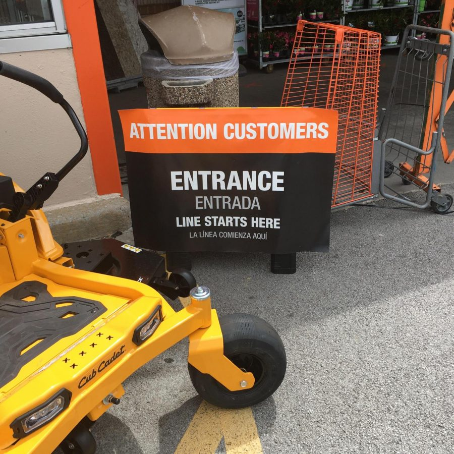 Home Depot displays an entrance sign to promote social distancing.