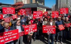 Hundreds of people are participating in a rally in support of the Chinese and people around the world fighting against the Coronavirus. The protest seen here calls for the understanding of communities and support of businesses in the United States.