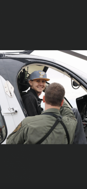 """Sullivan """"Sulley"""" Menne ('20) got the opportunity to ride in a helicopter during his battle with cancer. He was so excited and his family was so honored that they got to do that."""
