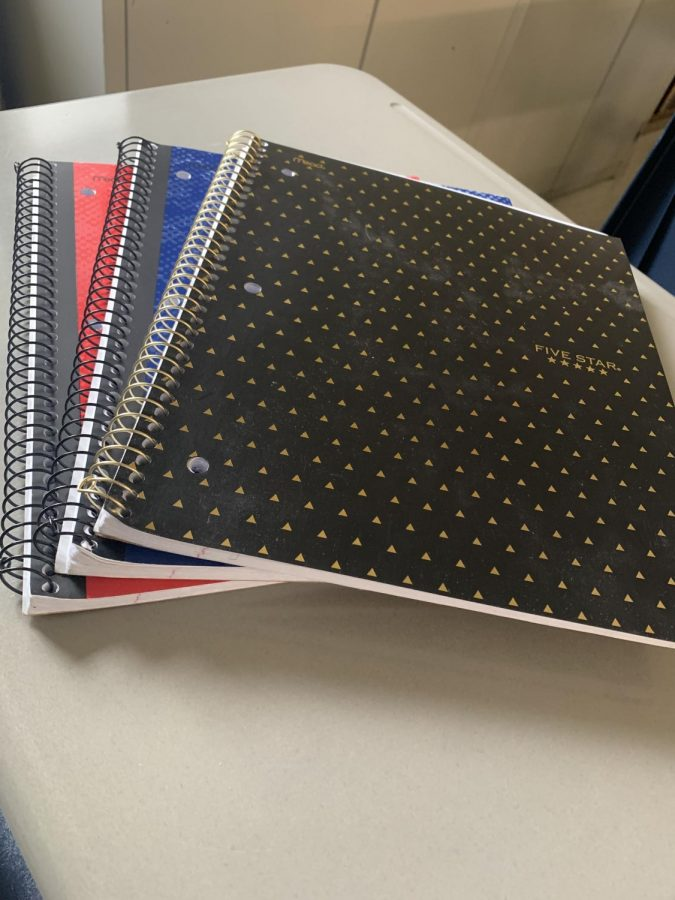 Keeping separate notebooks is one way students can help keep track of things.