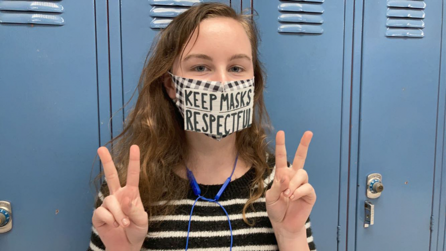 Kinslee Keatts ('22) poses wearing a respectful message on her mask. Make sure what you decide to wear is also repectful!