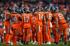 The Broncos huddle before a game.