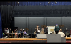 The cast and crew work hard during rehearsal. Preparing for the upcoming March show.