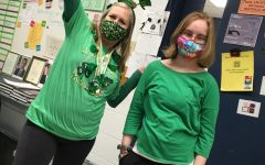 Sydney Swanson and Emily Teismann (21) show spirit in wearing green on St Patrick's Day.