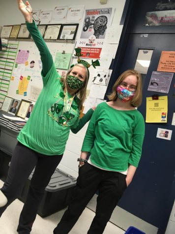 Sydney Swanson and Emily Teismann (21) show spirit in wearing green on St Patrick