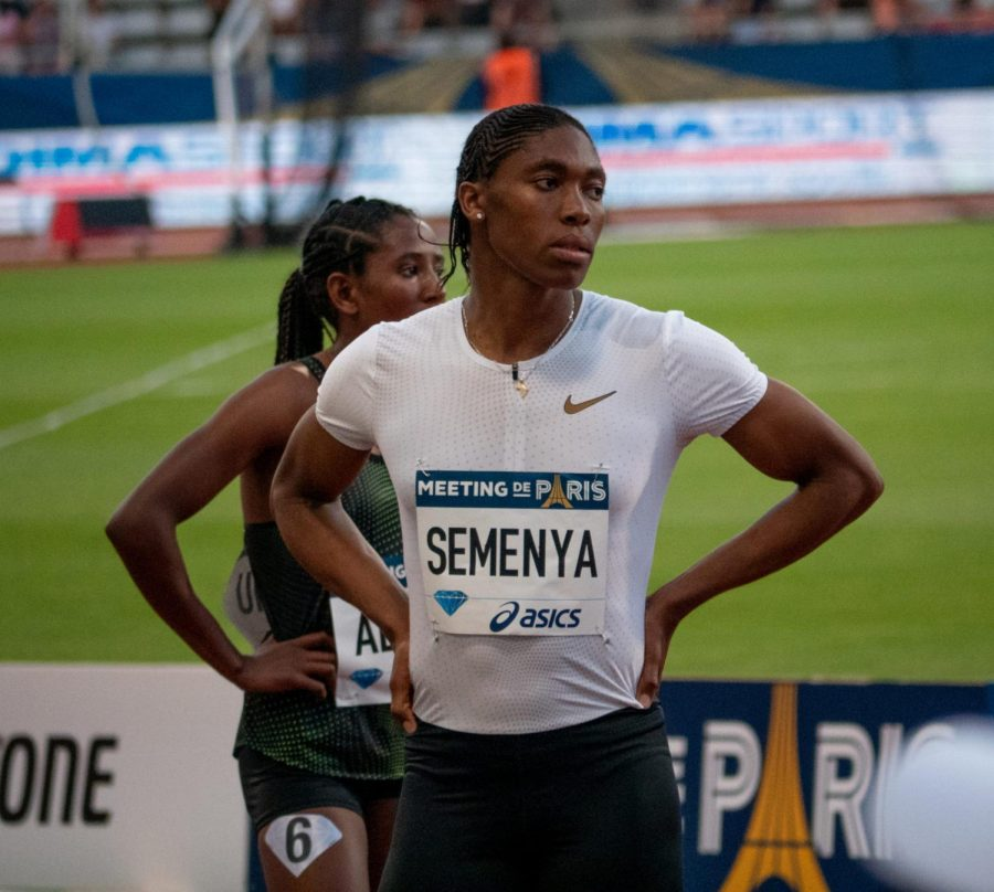 Caster+Semenya%2C+a+woman+who+despite+being+assigned+female+at+birth%2C+produces+larger+amounts+of+testosterone+than+the+average+woman+due+to+a+sexual+development+disorder+-+causing+controversy+as+to+whether+her+racing+as+a+woman+is+fair+or+not.